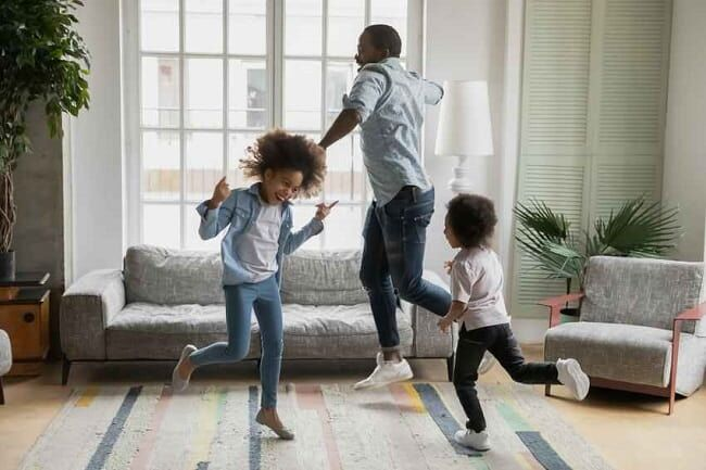 kids playing with father